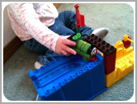 Playing with toy train set