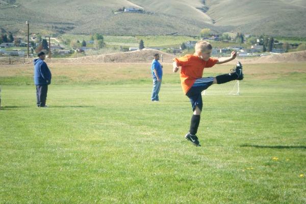 Super high kick on soccer field
