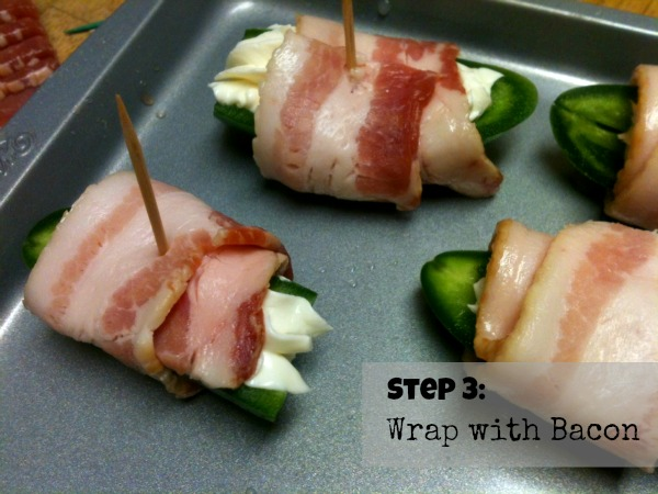 Wrapping peppers with bacon