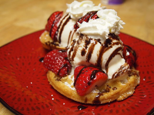 Deep Fried Waffles topped with ice cream and strawberries