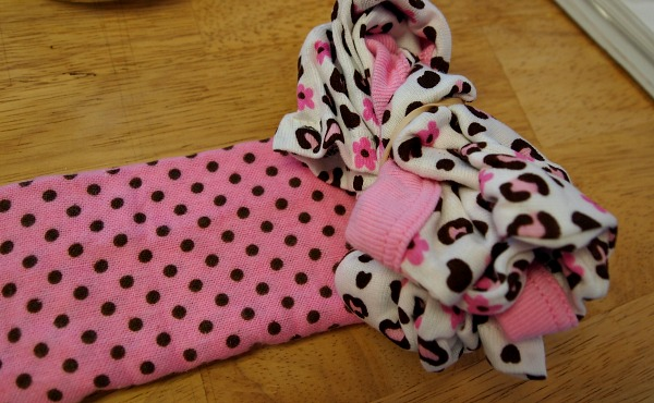 Making baby shower gifts with onesies and blankets